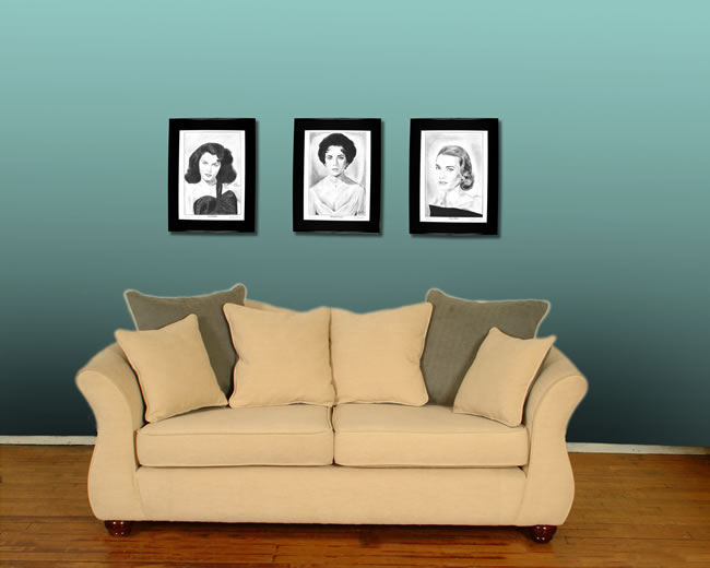 Framed prints above a sofa